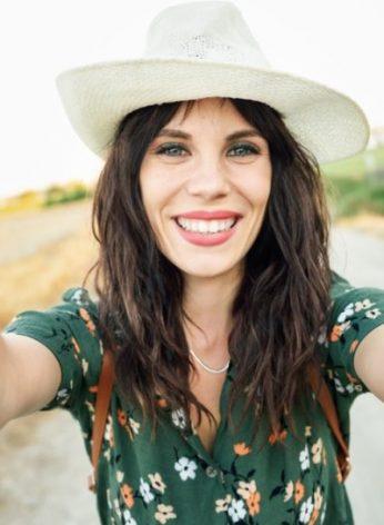 happy-woman-hat-selfie-smile-hiking-road